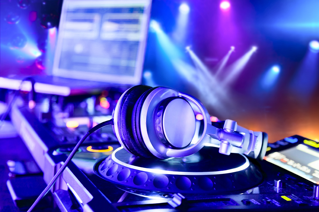 Dj mixer with headphones at nightclub